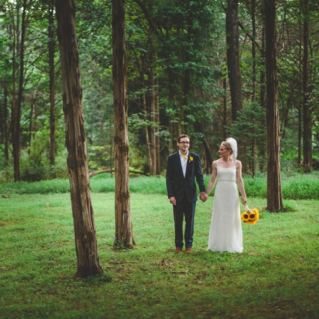 The groom wore a suit made by London's Geives & Hawkes as he held hands with his bride in a forest setting.