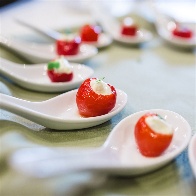 Guests enjoyed delicious appetizers, like these mozzarella-stuffed grape tomatoes.