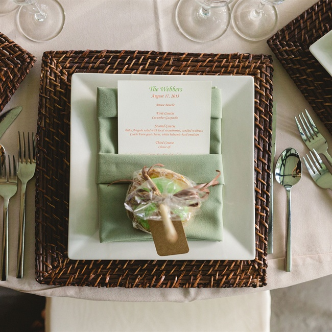 The place setting's earthy color palette carried out the couple's wooded wildflower theme.