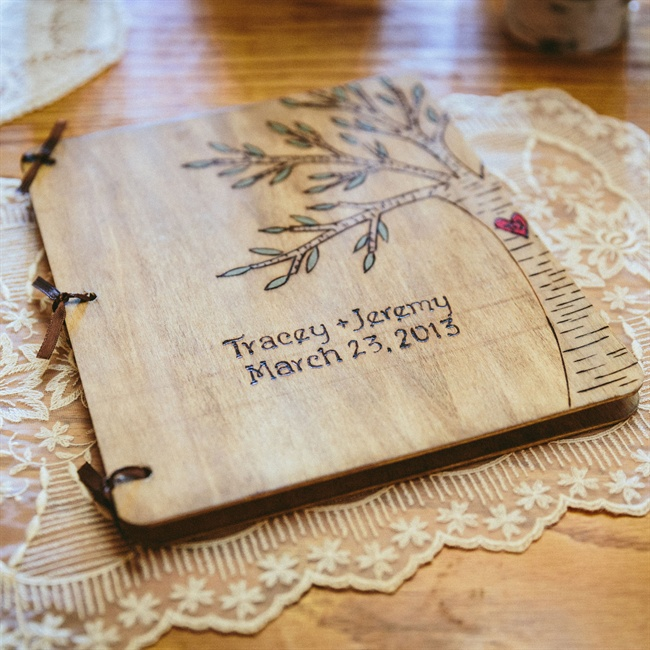 The day's program was written on a rustic wooden notebook.