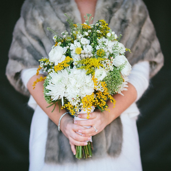 Tracey carried a bouquet of white ranunculuses, yellow fernleaf yarrows, mums and stock flowers.