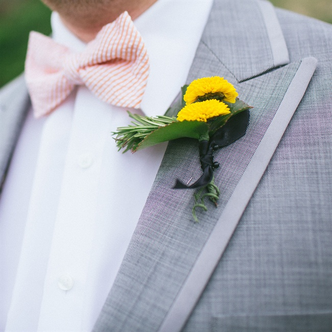 The groom accessorized with a bright yellow boutonniere and seersucker bow tie.