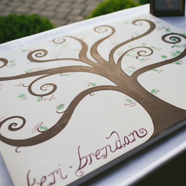 Guests were invited to add their thumbprint leaves to the couple's guest book tree.