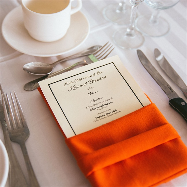 Neon orange napkins brightened up the reception tables.