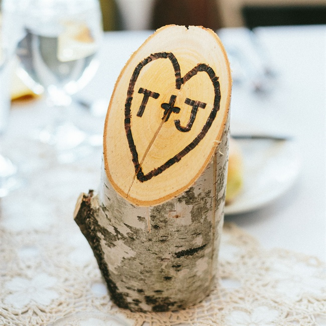 The couple used birch tree branches cut at an angle to decorate the reception space.
