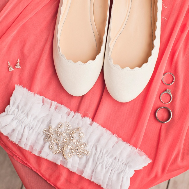 Andrea's girly, ivory Betsy Johnson flats perfectly complemented her bridesmaids coral color scheme.