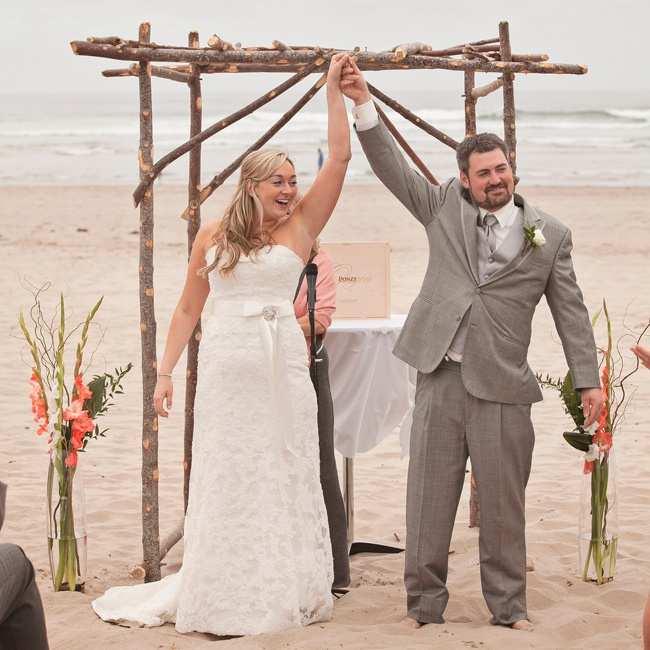 The couple's ceremony arch was constructed of thick tree branches and flanked by two tall floral arrangements.
