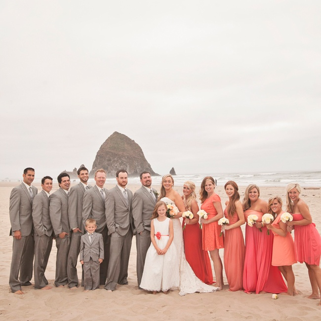Andrea sent her bridesmaids to the store with a paint swatch and told them to find whatever they liked best in that color palette. Colin's groomsmen wore light gray suits and accessorized with matching light gray ties.