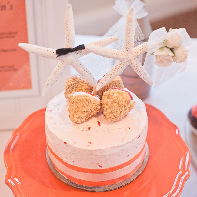 Andrea and Colin's beachfront wedding ended with the perfect cake topper decorations--starfish!