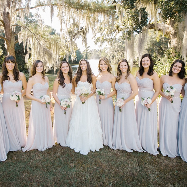 Bridesmaids wore formal-length blush dresses with a gray overlay and vintage beaded belts.