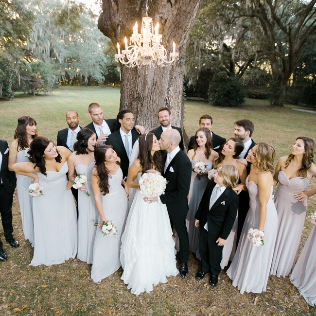 Groomsmen wore black tuxedos with matching gray ties to match the bridesmaids gray formal-length dresses.