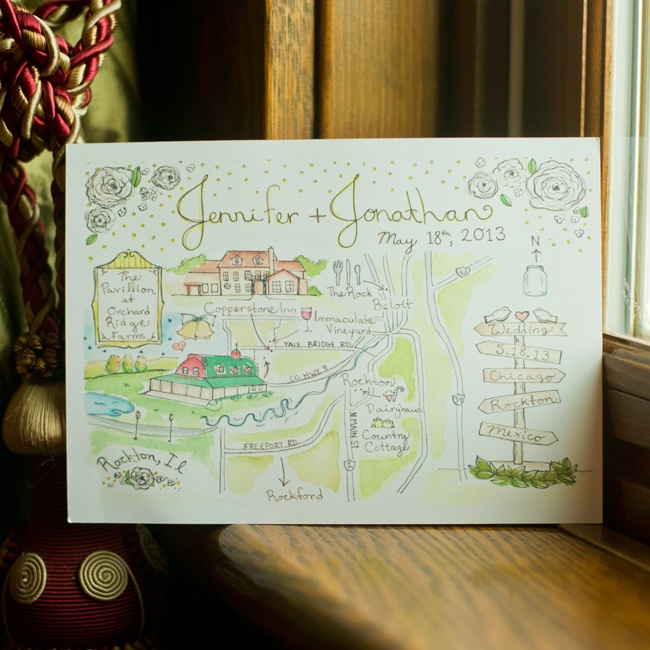 The couple used a hand-painted watercolor sign to give their guests a map of the day's events.