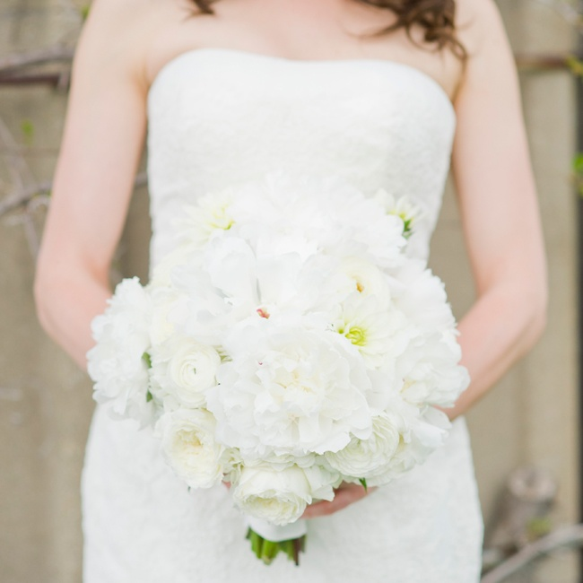 Jen carried a bouquet of classic white blooms down the aisle, including peonies, roses and ranuncluluses.