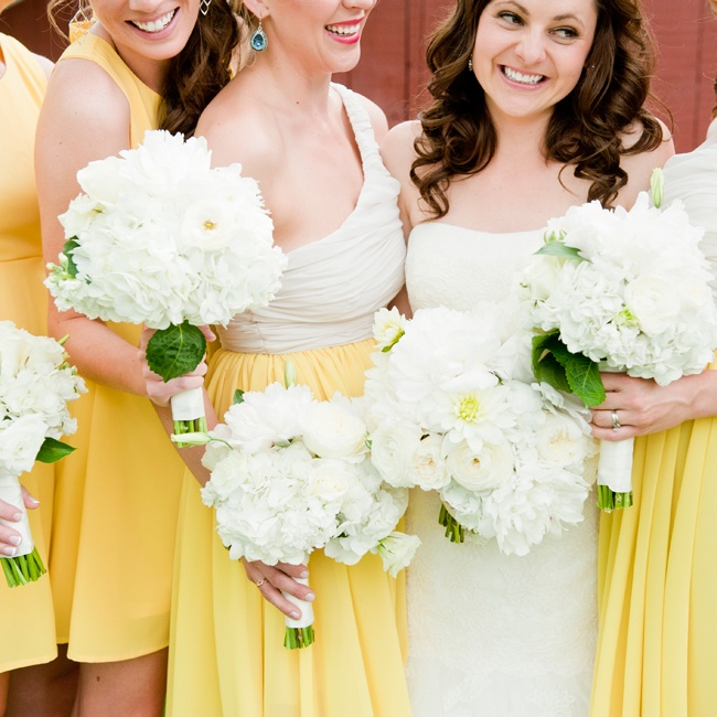 Bridesmaids wore yellow and white short dresses throughout the ceremony and reception.