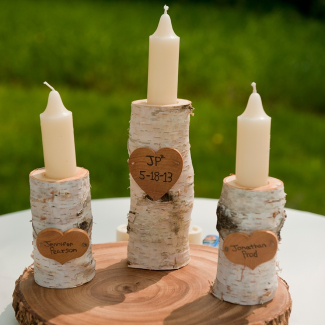 Jen and Jon created a woodland feel with some of their decor, including this set of unity candles placed in birch branches.