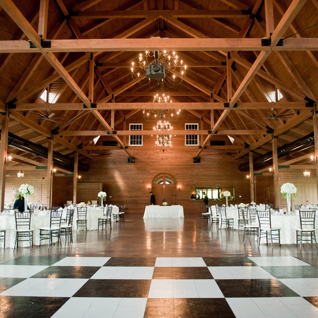 The reception was held in a barn hall and featured a checkerboard black and white dance floor.