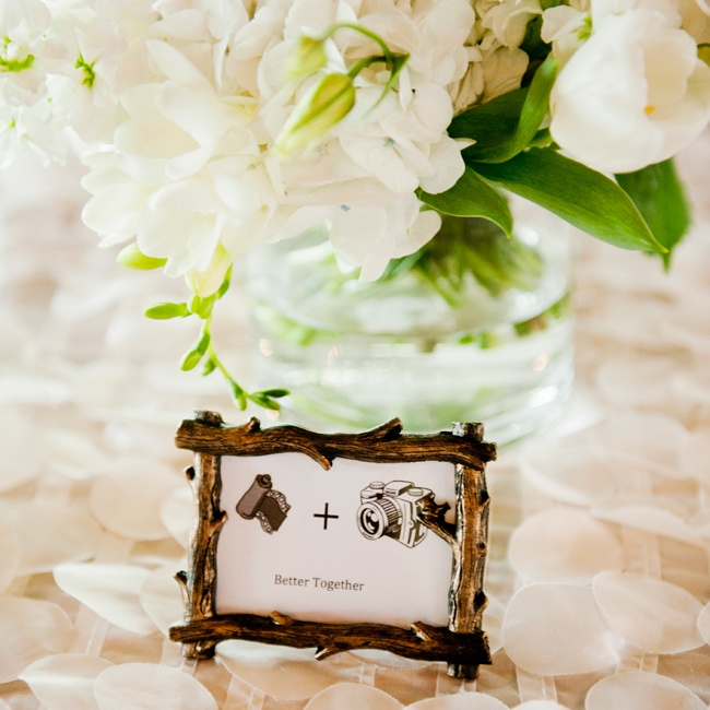 The reception featured tree branch decorations mixed with elegant floral arrangements.