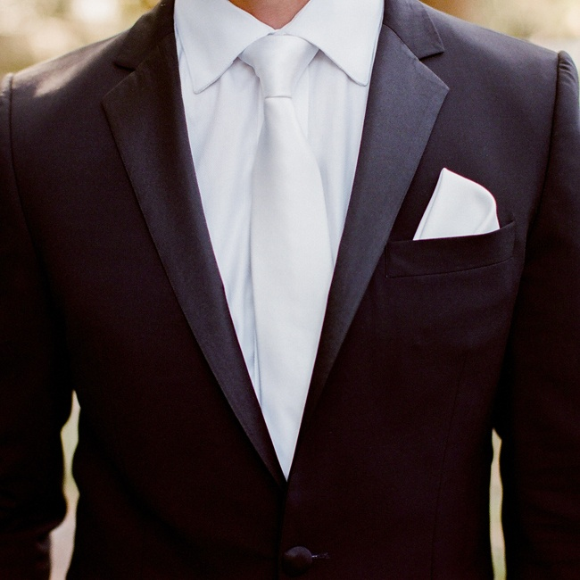 Rad wore a formal black tuxedo by Hugo Boss Red Label with a white satin tie and a white pocket square.