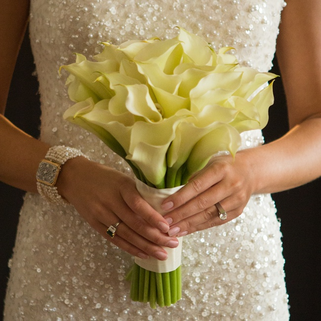 Jessie held a sleek bunch of cream calla lilies — the perfect complement to her glamorous, form-fitting beaded gown.