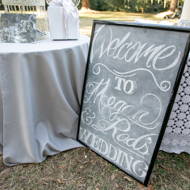 Megan and Rad welcomed guests to their wedding with a chalkboard sign outside the ceremony site.