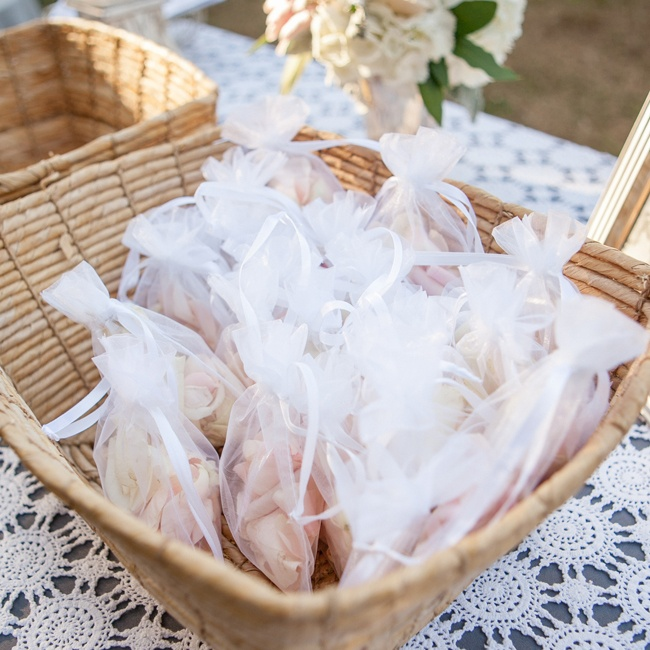 Guests received small bags of loose pink petals to throw once the couple exchanged vows.