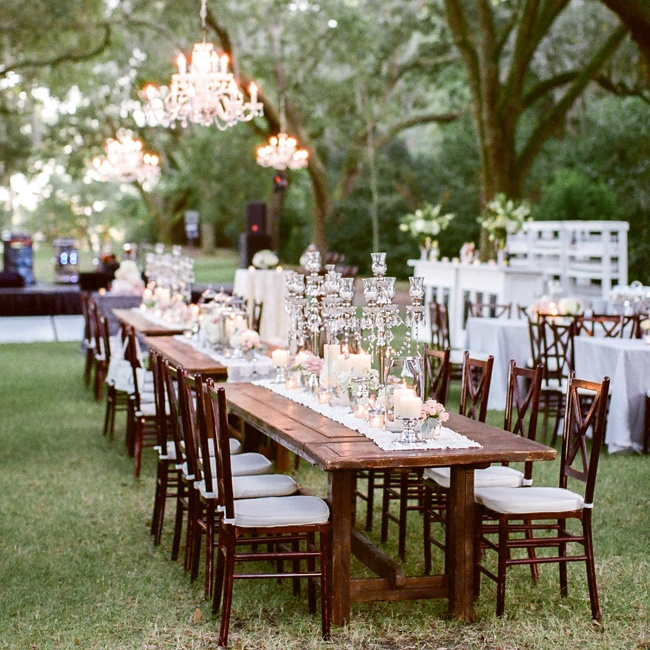 Megan and Rad combined chic candelabras and white tablecloths with the natural outdoor scenery of the plantation for a cool, rustic-sophisticated look.