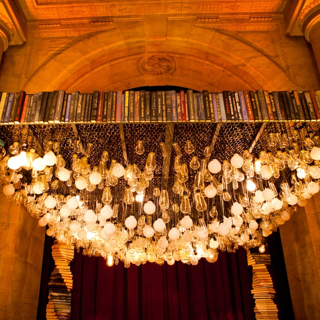 Jessie and Craig's custom wedding canopy was truly a work of art. The installation was made from 300 antique books and 500 lightbulbs that hung from its roof