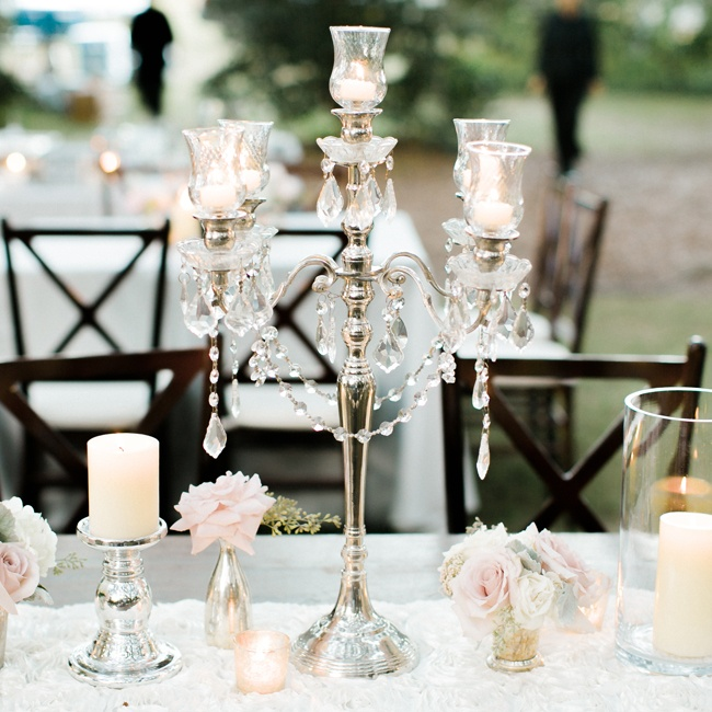 Crystal candelabras set with tea lights made for elegant centerpieces during the reception dinner.