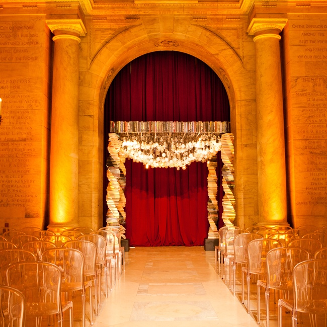 Letting their stunning wedding canopy take center stage, Jessie and Craig added only a crimson curtain and lucite Louis Ghost chairs to the library's Astor Hall.