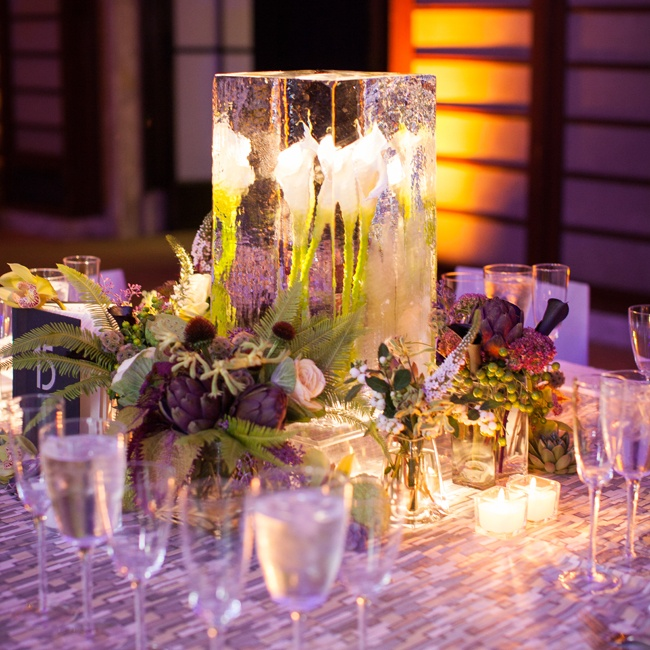 Calla lilies frozen inside blocks of ice were the focal point of the square reception tables. Votives, purple uplighting and pinspotting created a romantic glow in the library's Celeste Bartos Forum.