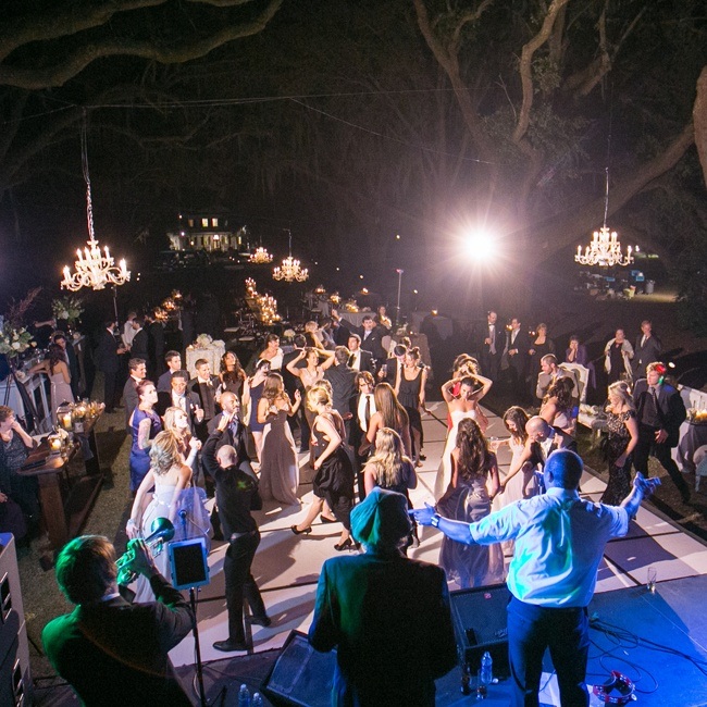 The dance floor was lit by four chandeliers hung in the oak trees above the guests.