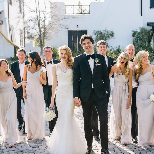The eight bridesmaids chose from three different dress styles in the same pale gray chiffon fabric. To keep things simple, the groomsmen wore their own suits and their choice of bow tie.