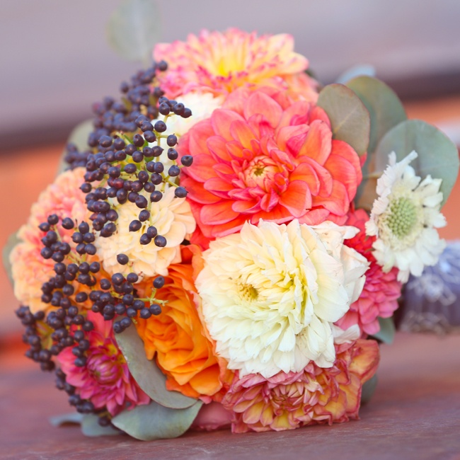 Brandi's bridal bouquet was made mostly of vibrant dahlias and dark berries.