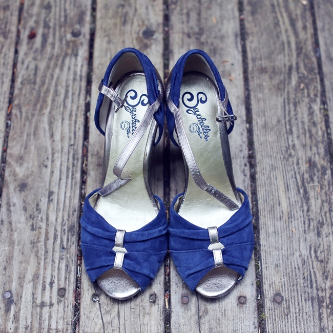 The bride wore blue peep-toe velvet shoes with silver accents.