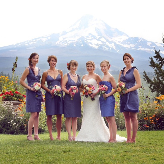 Brandi's bridesmaids wore muted purple dresses in different styles that complemented their vibrant bouquets.