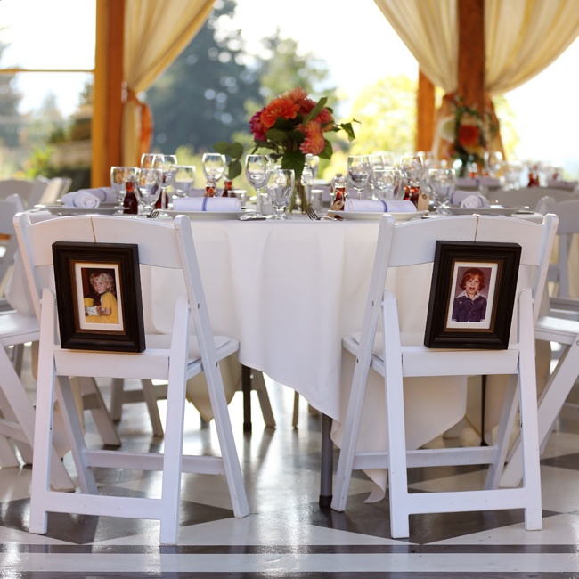 Vintage photos of the bride and groom were hung on the back of their chairs at the reception.