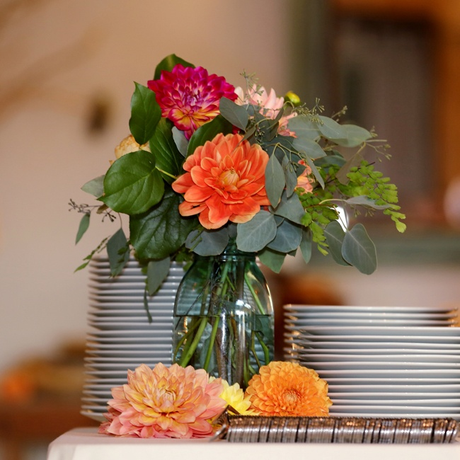 Colorful dahlias were used as low centerpieces throughout the reception space.