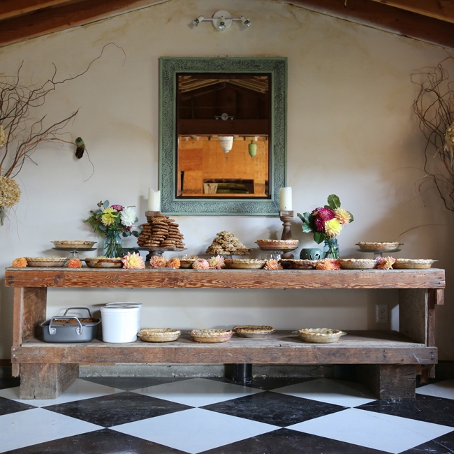 A wide variety of desserts, including pies, cookies and brownies, were set out on an antique baker's table for a rustic feel.
