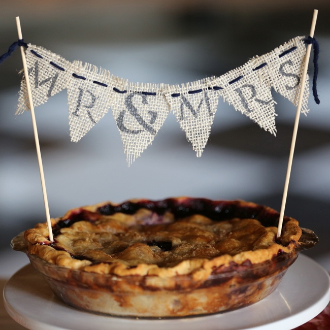 "The bride and groom shared a homemade pie with a burlap flag design that reads, ""Mr. & Mrs."""