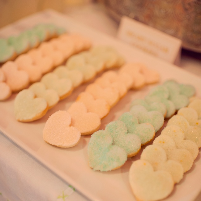 In addition to cake, guests snacked on heart-shaped sugar cookies in the wedding colors.