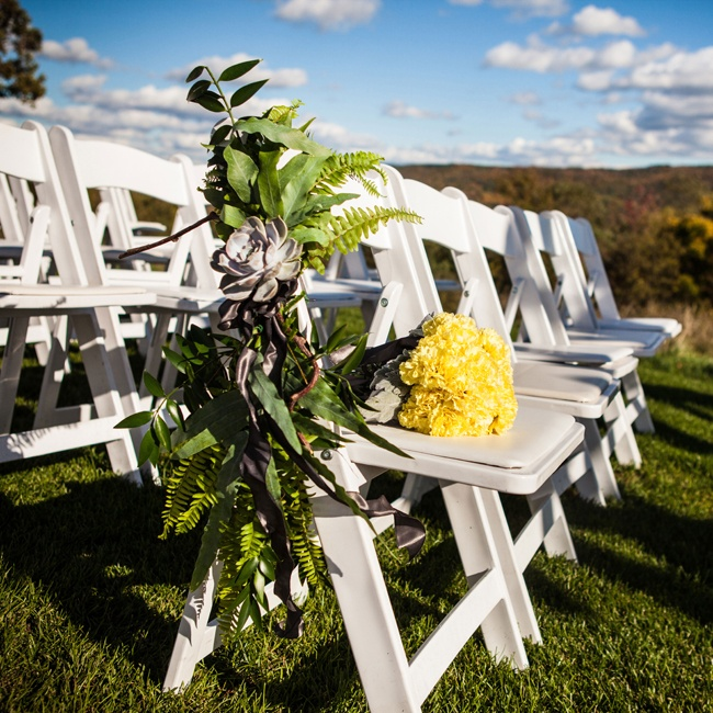 To fit with the rustic setting, the couple chose a succulent aisle marker for ceremony decor.