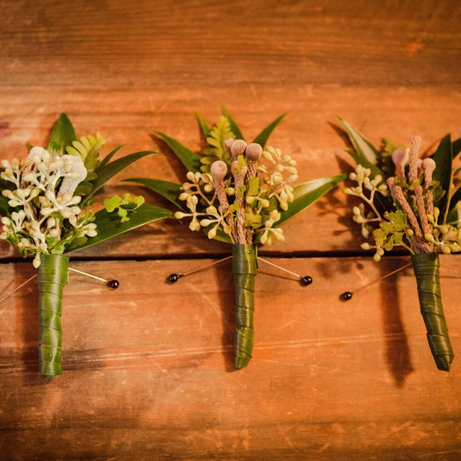 Each Groomsmen sported a matching green and brown boutonniere.