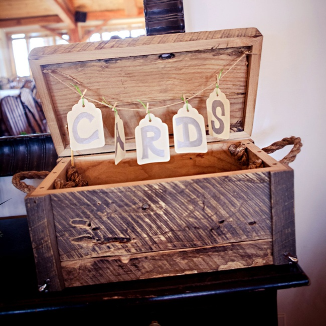 A distressed chest made for the perfect place for guests to drop their cards.