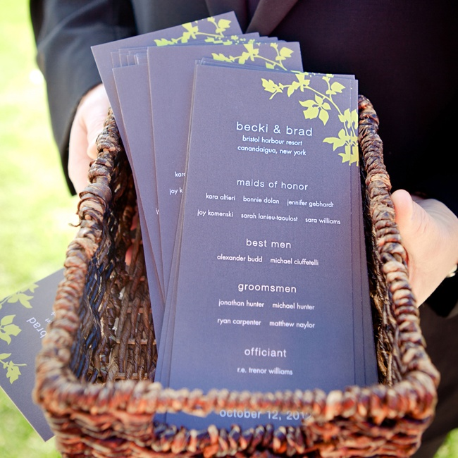 Green accents add an outdoor touch to these printed wedding programs.