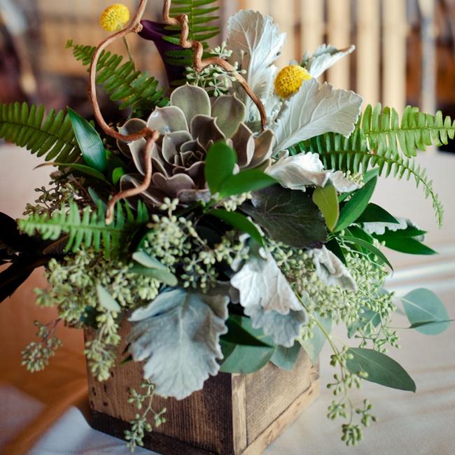 Stunning succulent arrangements fill distressed wood vases.