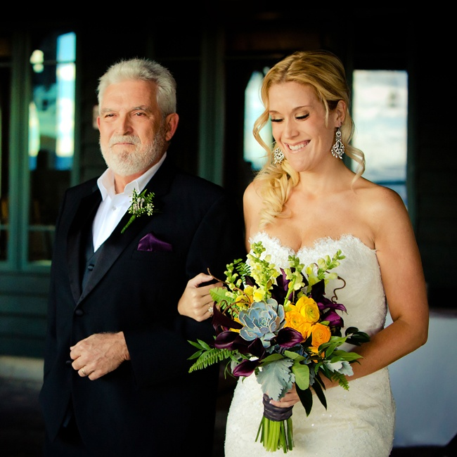 Becki is escorted down the aisle while showing off her beautiful succulent bouquet.