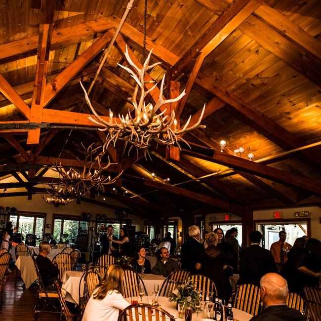 Antler chandeliers give a warm glow to the intimate reception.