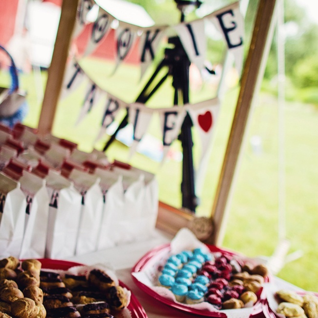 The groom's family made all of the desserts that filled the adorable cookie table.
