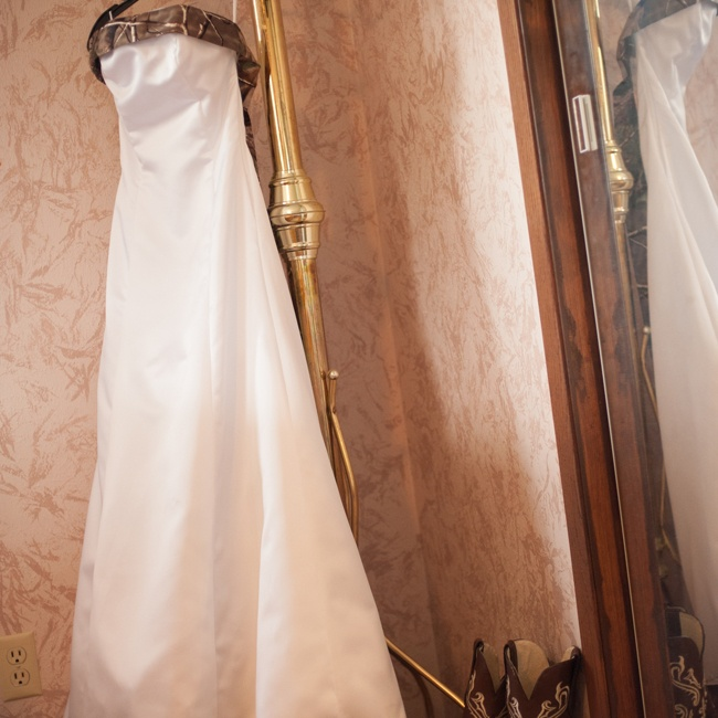Tayler chose a wedding dress that matched her theme. She wore a white, A-line, strapless gown complete with a camo trim and train.