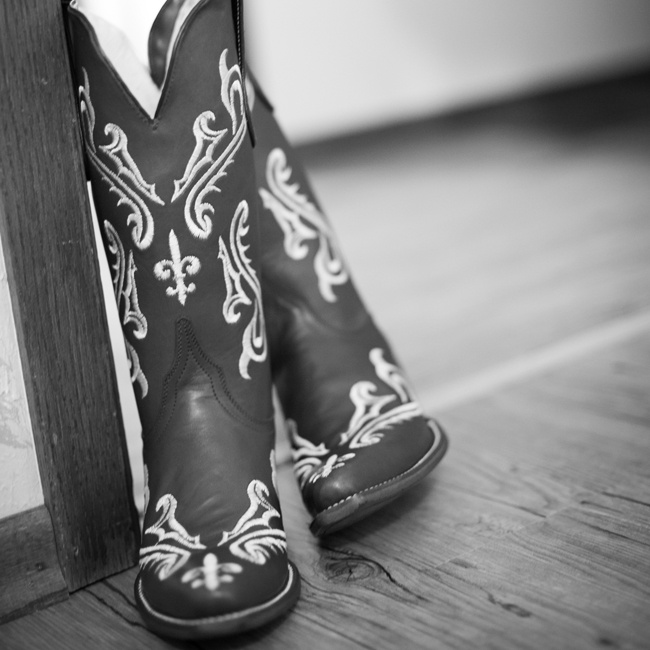 Tayler selected a pair of cowboy boots as her bridal shoes with beautiful fluer de lis stitching from Kelly's Cowboy Company.